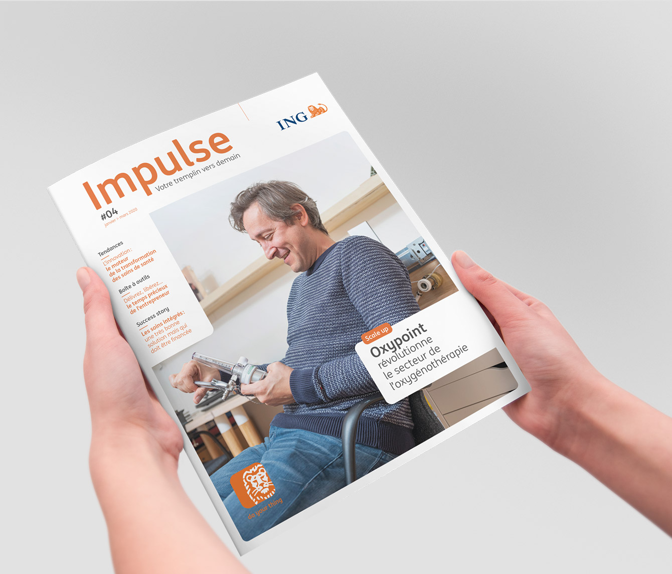 Hands holding print magazine